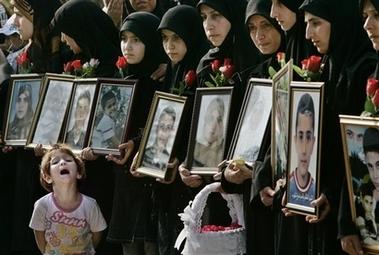 20060903015445-capt.84cb0d9e32604aa49833def73584fc02.lebanon-israel-mideast-qana-funeral-axlp109-1-.jpg